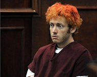 James Holmes appears in court at the Arapahoe County Justice Center July 23 in Centennial, Colorado. The suspected Batman massacre gunman was seeing a psychiatrist specializing in schizophrenia before the attack that killed 12 in Colorado, court documents showed Friday