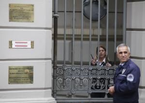 Police officers stand guard outside the German Consulate …