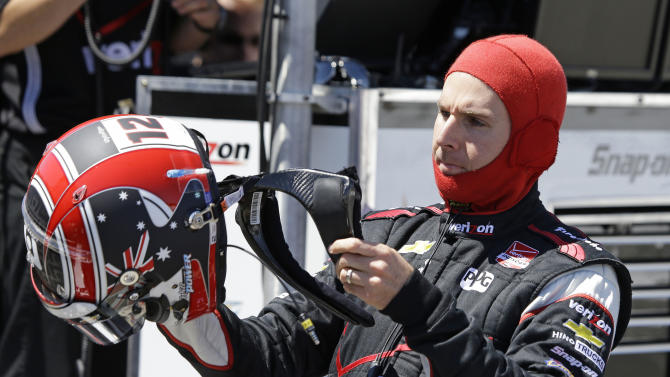 Will Power, of Australia, puts on his helmet before the start of practice for the IndyCar auto race Saturday, Aug. 23, 2014, in Sonoma, Calif. (AP Photo/Eric Risberg)