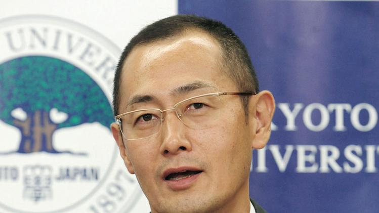 Kyoto University Professor Shinya Yamanaka speaks during a news conference at Kyoto University in Kyoto, western Japan, Monday, Oct. 8, 2012, after learning that he and British researcher John Gurdon won this year's Nobel Prize in physiology or medicine. The prize committee at Stockholm's Karolinska Institute said the two won the prize for discovering that mature, specialized cells of the body can be reprogrammed into stem cells — a discovery that scientists hope to turn into new treatments. (AP Photo/Kyodo News) JAPAN OUT, MANDATORY CREDIT, NO LICENSING IN CHINA, FRANCE, HONG KONG, JAPAN AND SOUTH KOREA