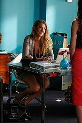 Serena's white molded plastic office chair looks ergonomic enough for a hard day of celebrity…