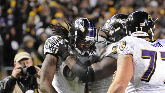 Baltimore Ravens wide receiver Torrey Smith (82) celebrates with teammates after catching a touchdown pass to beat the Pittsburgh Steelers 23-20, with 8 seconds left in the fourth quarter of the NFL football game, Sunday, Nov. 6, 2011, in Pittsburgh. (AP Photo/Don Wright)