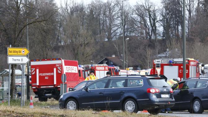 Cars of firefighters are parked near Bad Aibling