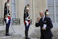 French Foreign Minister Laurent Fabius waves to photographers as he arrives at the Elysee Palace in Paris. Fabius was due in Algiers on Sunday on his first official trip to an Arab country, with the political crisis in neighbouring Mali featuring high on the agenda