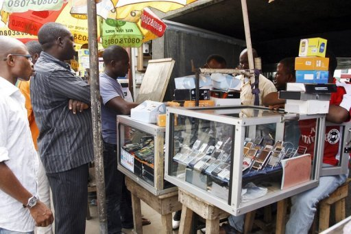 <p>File picture shows a mobile phone dealer in Lagos. It would seem to be a sure thing for firms offering mobile money transfers: large population, a growing economy and just about everyone has a mobile phone, but as with many things that seem to be a sure bet, particularly in Nigeria, there's a catch.</p>