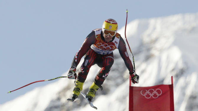 Croatia's Ivica Kostelic makes a jump during a men's downhill training run for the Sochi 2014 Winter Olympics, Friday, Feb. 7, 2014, in Krasnaya Polyana, Russia. (AP Photo/Charles Krupa)
