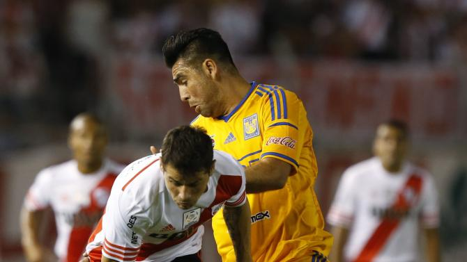 Rivas of Mexico's Tigre challenges Mora of Argentina's River Plate during their Copa Libertadores soccer match in Buenos Aires