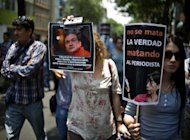 Mexican journalists protest the murders of colleagues, May 4. In Veracruz state security forces Thursday found the dismembered bodies of two missing news photographers and two others, just days after a magazine reporter was killed in the same state