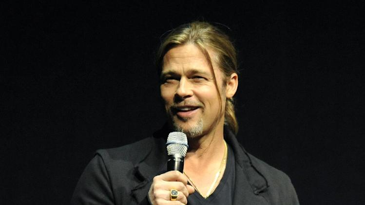 "Brad Pitt, a cast member in the forthcoming film ""World War Z,"" introduces a clip from the film at CinemaCon 2013's Opening Night Presentation from Paramount Pictures at Caesars Palace on Tuesday, April 15, 2013 in Las Vegas. (Photo by Chris Pizzello/Invision/AP)"