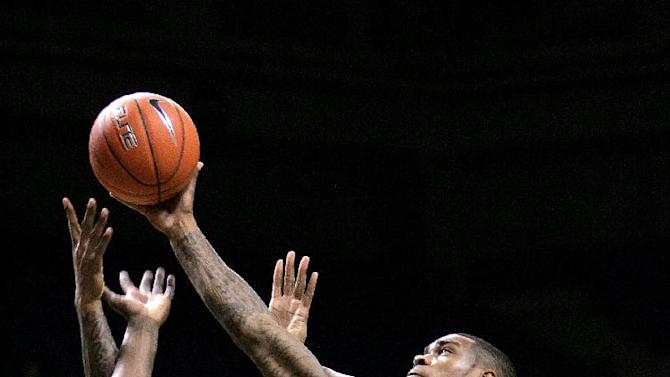 Cincinnati's Sean Kilpatrick, right, leaps above teammate Justin Jackson, left, and Marshall's Dennis Tinnon while trying to grab a rebound during an NCAA college basketball game, Saturday, Dec. 15, 2012, in Charleston, W.Va. Kilpatrick had six rebounds in Cincinnati's 72-56 victory against Marshall. (AP Photo/Randy Snyder)