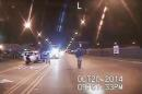 FILE - In this Oct. 20, 2014 frame from dash-cam video provided by the Chicago Police Department, 17-year-old Laquan McDonald, right, walks down the street moments before being shot by white officer Jason Van Dyke in Chicago. The Task Force on Police Accountability recommends abolishing the Independent Police Review Authority, which investigates officer misconduct. The panel was created in the wake of protests over Van Dyke's fatal shooting of McDonald. (Chicago Police Department via AP, File)