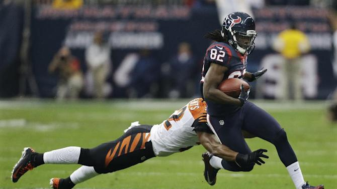 Houston Texans wide receiver Keshawn Martin (82) is tackled by Cincinnati Bengals strong safety Nate Clements (22) during the first quarter of an NFL wild card playoff football game Saturday, Jan. 5, 2013, in Houston. (AP Photo/Eric Gay)