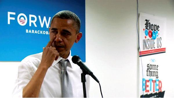 Obama wipes away tears while speaking to staff