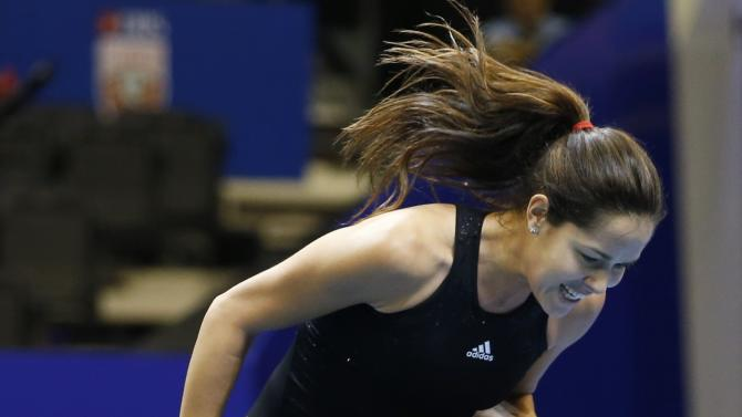 Micromax Indian Aces' Ivanovic of Serbia reacts after winning a point against Singapore Slammers' Williams during their women's singles match at the International Premier Tennis League (IPTL) in Singapore