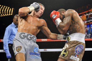 Gennady Golovkin (silver trunks) hits Curtis Stevens during their middleweight title fight. (USA Today)