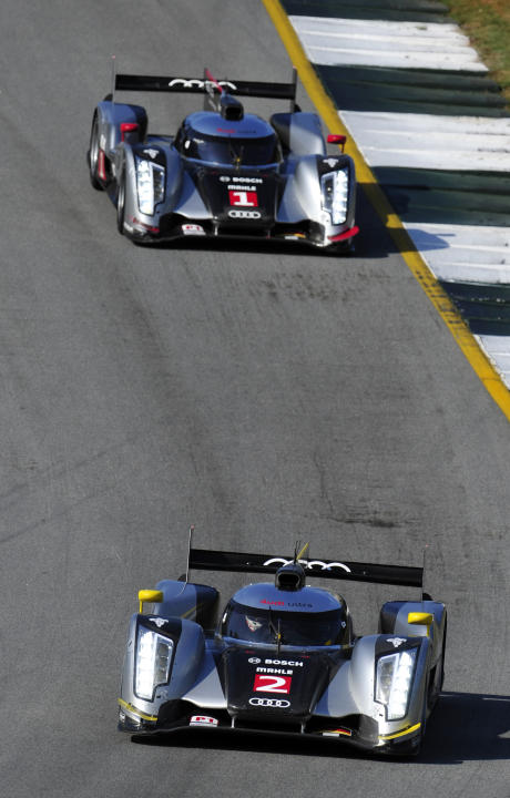 Audi Sport driver Tom Kristensen, of Denmark, leads teammate Romain Dumas, of France, as they go through a corner during practice for the American Le Mans Series' Petit Le Mans auto race at Road Atlan
