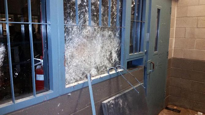 This undated photo provided by the Arizona Department of Corrections, shows the damage at the Arizona State Prison-Kingman in Kingman, Ariz. Days of unrest at a privately run prison in Arizona became a nightmare scenario as inmates rioted, trashed housing units and injured guards, prompting the governor to order an investigation Monday, July 6, 2015, into the problem at the facility. (Arizona Department of Corrections via AP)