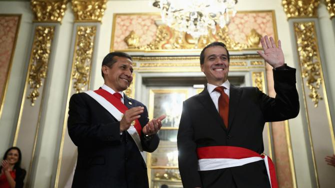 Peru's President Humala claps as New Finance Minister Segura waves, after the swearing-in ceremony at the government palace in Lima