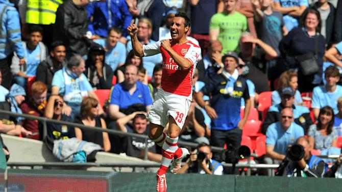 Arsenal's Spanish midfielder Santi Cazorla celebrates scoring the opening goal during the FA Community Shield football match between Arsenal Manchester City at Wembley Stadium in north London on August 10, 2014