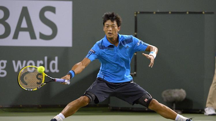 Lu Yen-Hsun, of Taiwan, returns a shot to John Isner, of the United States, at the BNP Paribas Open tennis tournament, Tuesday, March 11, 2014, in Indian Wells, Calif. (AP Photo/Mark J. Terrill)