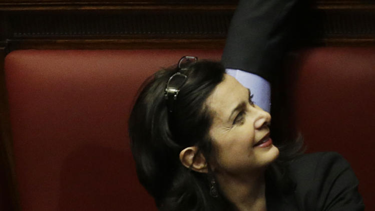 Italian lawmaker Laura Boldrini looks up before being elected president of the lower chamber in Rome, Saturday, March 16, 2013. (AP Photo/Gregorio Borgia)