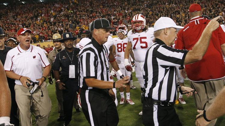 Wisconsin head coach Gary Andersen, far left, yells at officials as they attempt to leave the field after an NCAA college football game against Arizona State on Saturday, Sept. 14, 2013, in Phoenix. Arizona State defeated Wisconsin 32-30. (AP Photo/Ross D. Franklin)