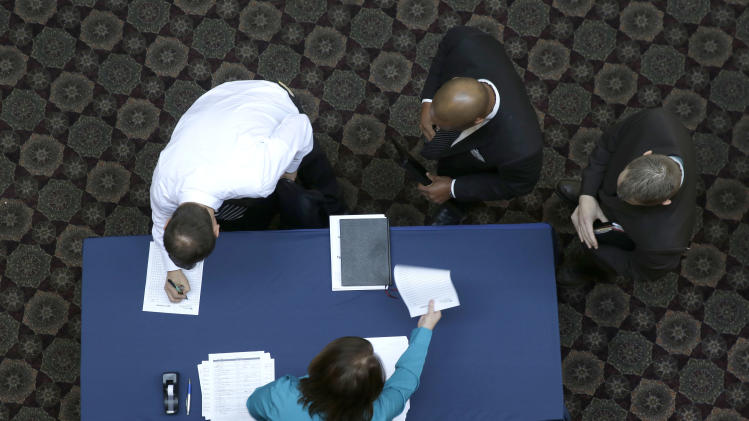 FILE - In this Wednesday, Jan. 22, 2014, file photo, job seekers sign in before meeting prospective employers during a career fair at a hotel in Dallas. The Labor Department releases the job openings and labor turnover survey for December on Tuesday, Feb. 11, 2014. (AP Photo/LM Otero, File)