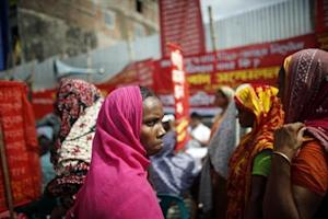 Garment workers who survived the Rana Plaza building collapse take part in a protest to demand for compensation, on the six month anniversary of the incident, in front of the site in Savar