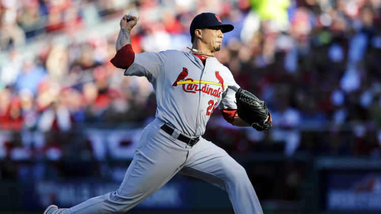 St. Louis Cardinals starting pitcher Kyle Lohse throws to the Washington Nationals in the second inning of Game 4 of the National League division baseball series on Thursday, Oct. 11, 2012, in Washington. (AP Photo/Nick Wass)