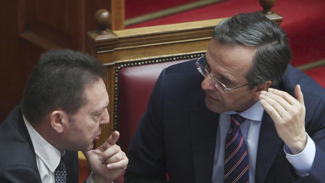 Greece outlines new austerity as debt load rises