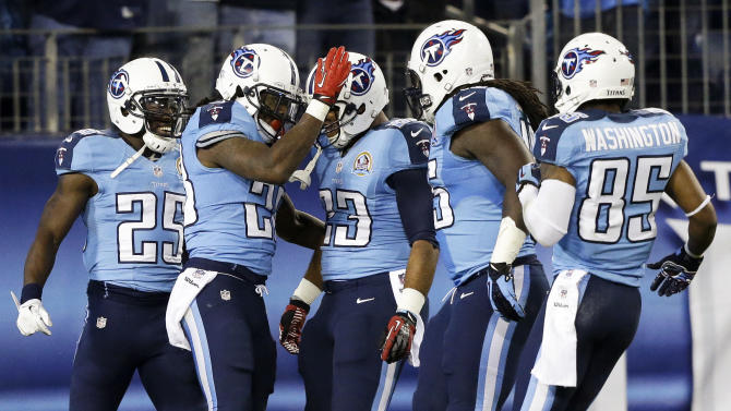 Tennessee Titans running back Chris Johnson, second from left, celebrates with teammates including running back Darius Reynaud (25), running back Jamie Harper (23) and wide receiver Nate Washington (85) after running for a 94-yard touchdown against the New York Jets in the second quarter of an NFL football game, Monday, Dec. 17, 2012, in Nashville, Tenn. (AP Photo/Wade Payne)