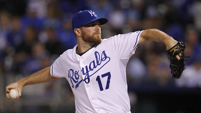 Kansas City Royals relief pitcher Wade Davis throws in the eighth inning of a baseball game against the Chicago White Sox at Kauffman Stadium in Kansas City, Mo., Wednesday, Sept. 17, 2014. (AP Photo/Colin E. Braley)
