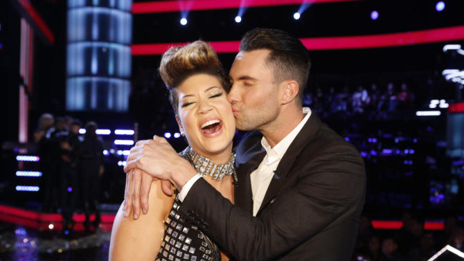 """In this photo provided by NBC, Maroon 5 frontman Adam Levine, right, kisses Tessanne Chin on the cheek after Chin was announced the season five winner of """"The Voice"""" on Tuesday, Dec. 17, 2013, in Los Angeles. Chin a 28-year-old Kingston native had nearly given up on her dreams before landing a spot on the NBC singing competition. Levine was Chin's coach. (AP Photo/NBC,Trae Patton)"""