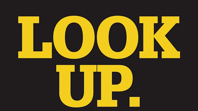 An undated handout image provided by Delaware State Office of Highway Safety shows a the decal aimed at getting distracted pedestrians to look up from their mobile devices and watch where they're walking.  The decals are 2 feet by 2 feet, made of nonskid material. Across the country on city streets, in suburban parking lots and in shopping centers, there is usually someone strolling while talking on a phone, texting with their head down, listening to music, or playing a video game. The problem isn't as widely discussed as distracted driving, but the danger is real.  (AP Photo/Delaware State Office of Highway Safety)