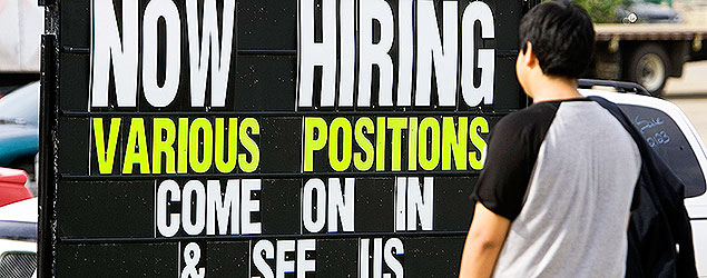 One of many help wanted signs advertising for workers in downtown Fort McMuurray, Alberta. (CP PHOTO/Larry MacDougal)
