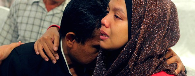 Family members of those onboard the missing Malaysia Airlines flight MH370 cry at a hotel in Putrajaya. (Zulfadhli Zaki/Reuters)