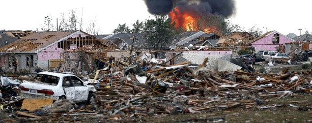 A fire burns in the Tower Plaza Addition in Moore, Okla., after a deadly tornado. (Sue Ogrocki/AP)