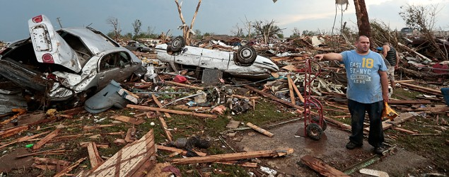 Philip Gotcher stands in the rubble of his house after a powerful tornado ripped through Moore, Oklahoma. (Brett Deering/Getty Images)