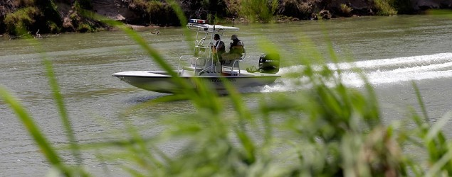 Law enforcement officials patrol the Rio Grande in an area where immigrants cross the U.S.-Mexico border illegally. (AP)