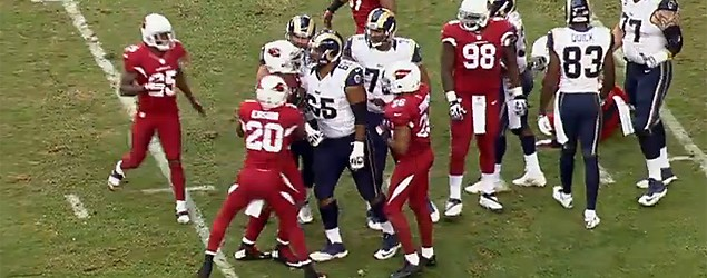 Camera catches dirty act by NFL player Darnell Dockett. (NFL.com)