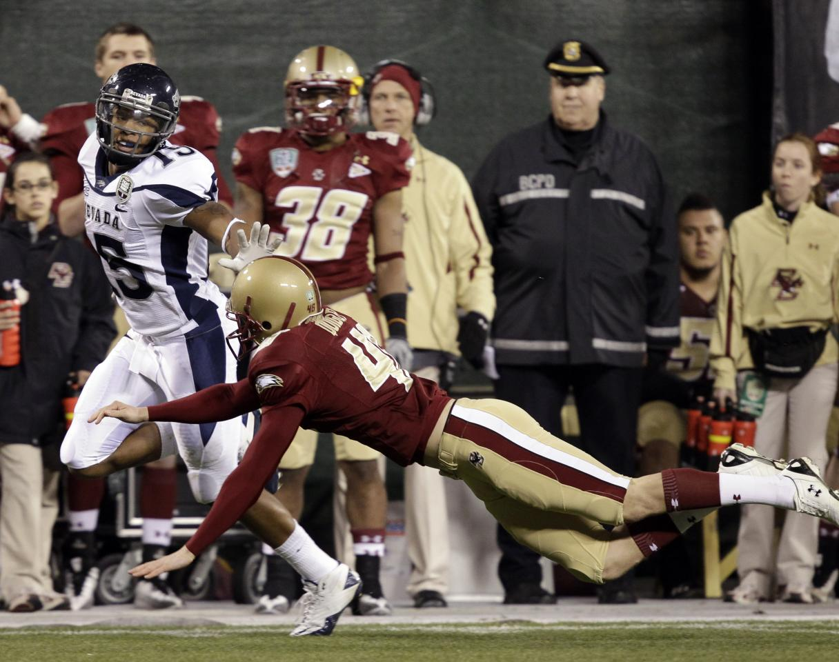 Nevada wide receiver Rishard Matthews (15) runs past Boston College punter Ryan Quigley (46) on a 72-yard punt return for a touchdown during the first half of the Fight Hunger Bowl NCAA college football game in San Francisco, Sunday, Jan. 9, 2011.