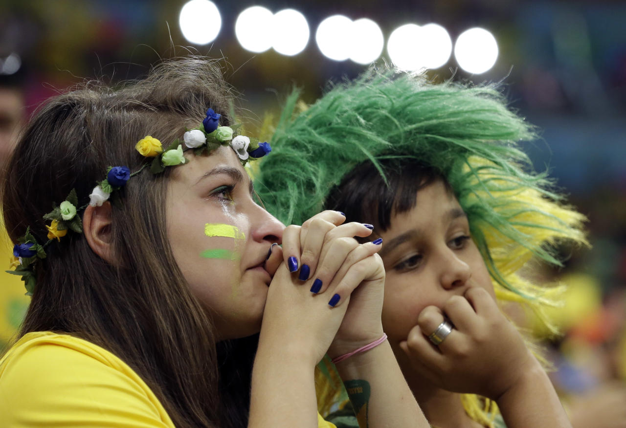 Brazil supporters react after the World Cup third-place soccer match between Brazil and the Netherlands at the Estadio Nacional in Brasilia, Brazil, Saturday, July 12, 2014. The Netherlands won the match 3-0. (AP Photo/Hassan Ammar)
