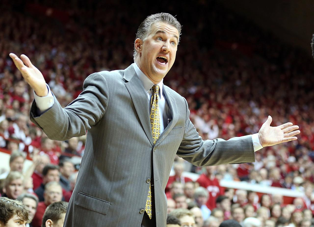 Matt Painter the head coach of the Purdue Boilermakers gives instructions to his team during the game against the  Indiana Hoosiers at Assembly Hall on February 16, 2013 in Bloomington, Indiana.  (Photo by Andy Lyons/Getty Images)