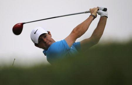 McIlroy tees off on the third hole during Abu Dhabi Golf championship