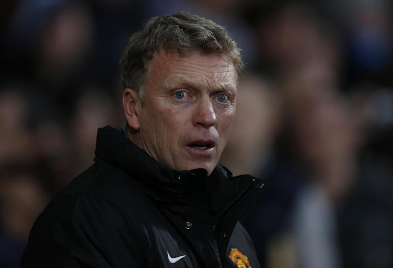 Manchester United's manager David Moyes looks on from the dugout before the start of their English Premier League soccer match against West Ham United at Upton Park, London, Saturday, March 22, 2014