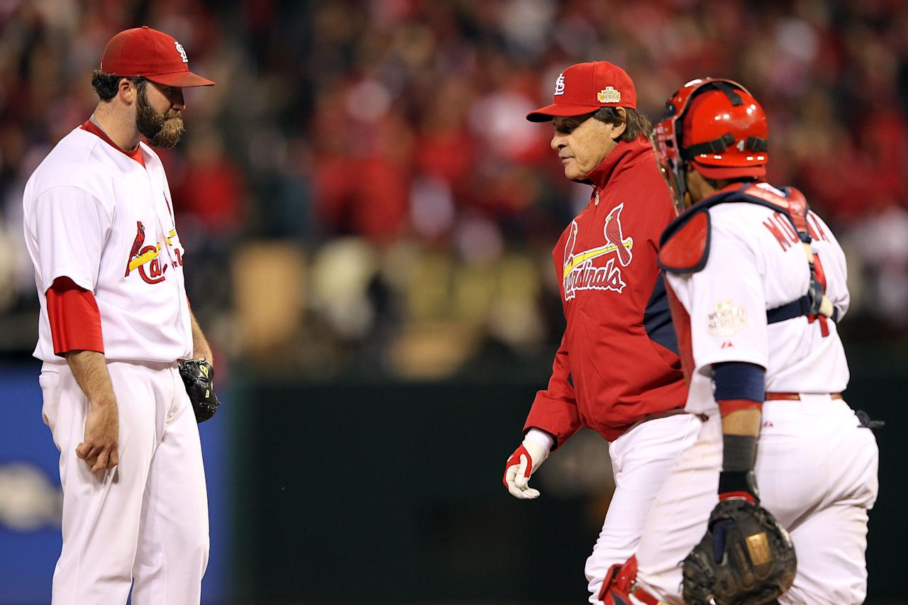 ST LOUIS, MO - OCTOBER 20:  Manager Tony La Russa removes pitcher Jason Motte #30 of the St. Louis Cardinals in the ninth inning during Game Two of the MLB World Series against the Texas Rangers at Busch Stadium on October 20, 2011 in St Louis, Missouri.  (Photo by Jamie Squire/Getty Images)