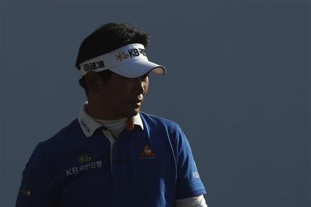 Yang of South Korea walks on the 18th hole during the third round of the Hong Kong Open golf tournament at the Hong Kong golf club