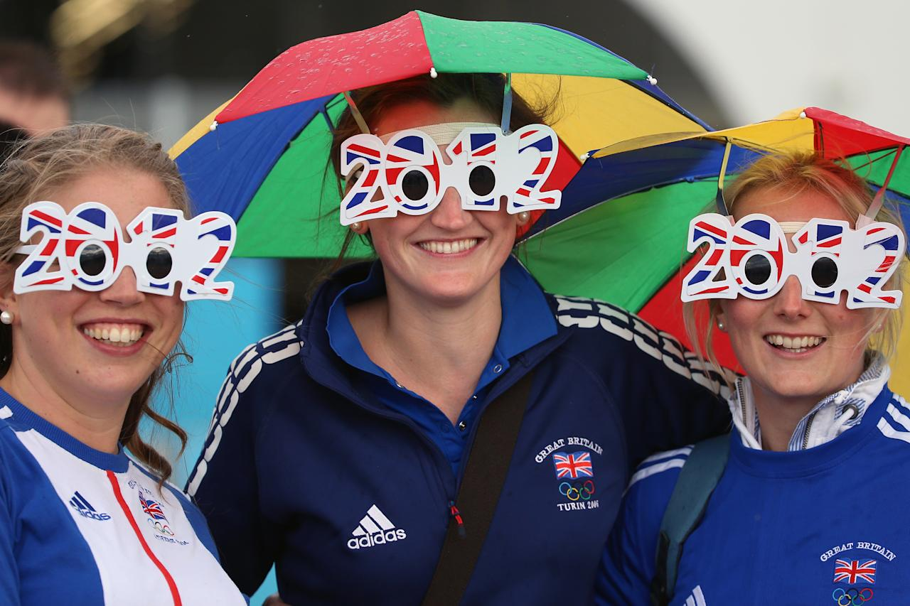 LONDON, ENGLAND - JULY 29:  Members of the wear 2012 glasses at Olympic Park on Day 2 of the London 2012 Olympic Games on July 29, 2012 in London, England.  (Photo by Jeff J Mitchell/Getty Images)