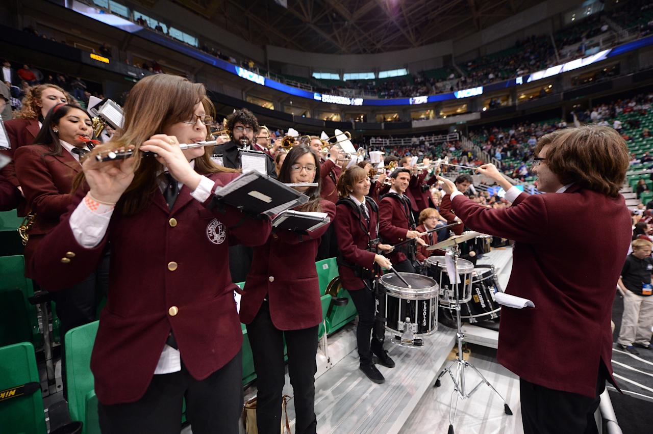 SALT LAKE CITY, UT - MARCH 23:  The Harvard Crimson band performs before the Crimson take on the Arizona Wildcats during the third round of the 2013 NCAA Men's Basketball Tournament at EnergySolutions Arena on March 23, 2013 in Salt Lake City, Utah.  (Photo by Harry How/Getty Images)