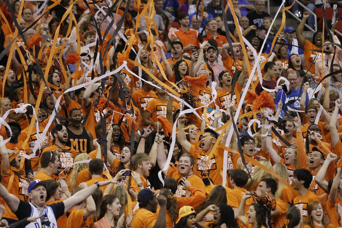 Mercer fans cheer during the first half of an NCAA college basketball second-round game against the Duke, Friday, March 21, 2014, in Raleigh, N.C. (AP Photo/Gerry Broome)